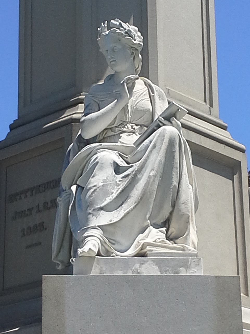 Statue of Clio, Greek muse of history, from the Soldiers' National Monument at Gettysburg National Cemetery. Photo by Donaldecoho. Wikimedia Commons.